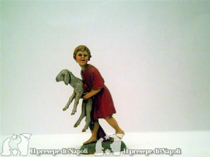 Bambino con pecora