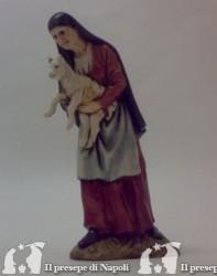 Vecchia con agnello in braccio