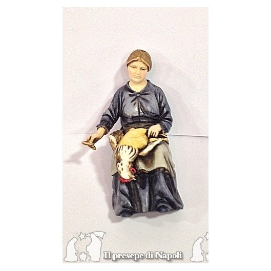 donna seduta con gallina