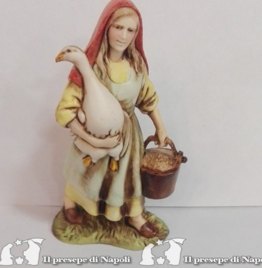 Donna con oca e cesta in mano