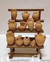 Banco con vasi terracotta h cm 13 x larg. cm 7 x prof massima cm 7
