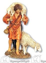 Uomo con pecora sulle spalle