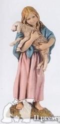 Bambina con agnello in braccio