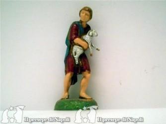 Ragazzo con pecora in braccio