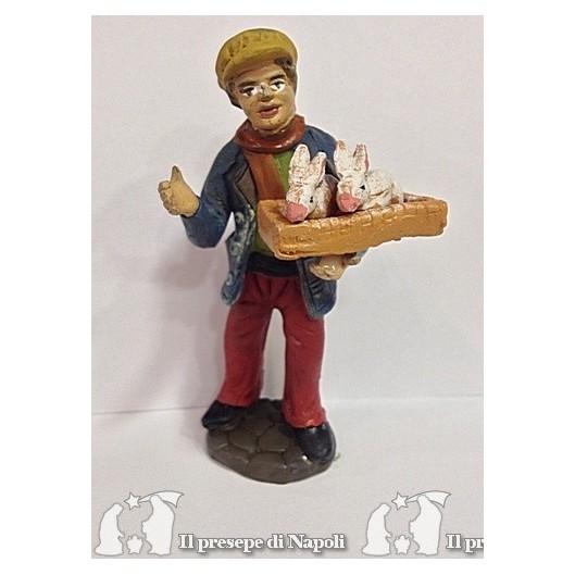 Uomo con cesta di conigli